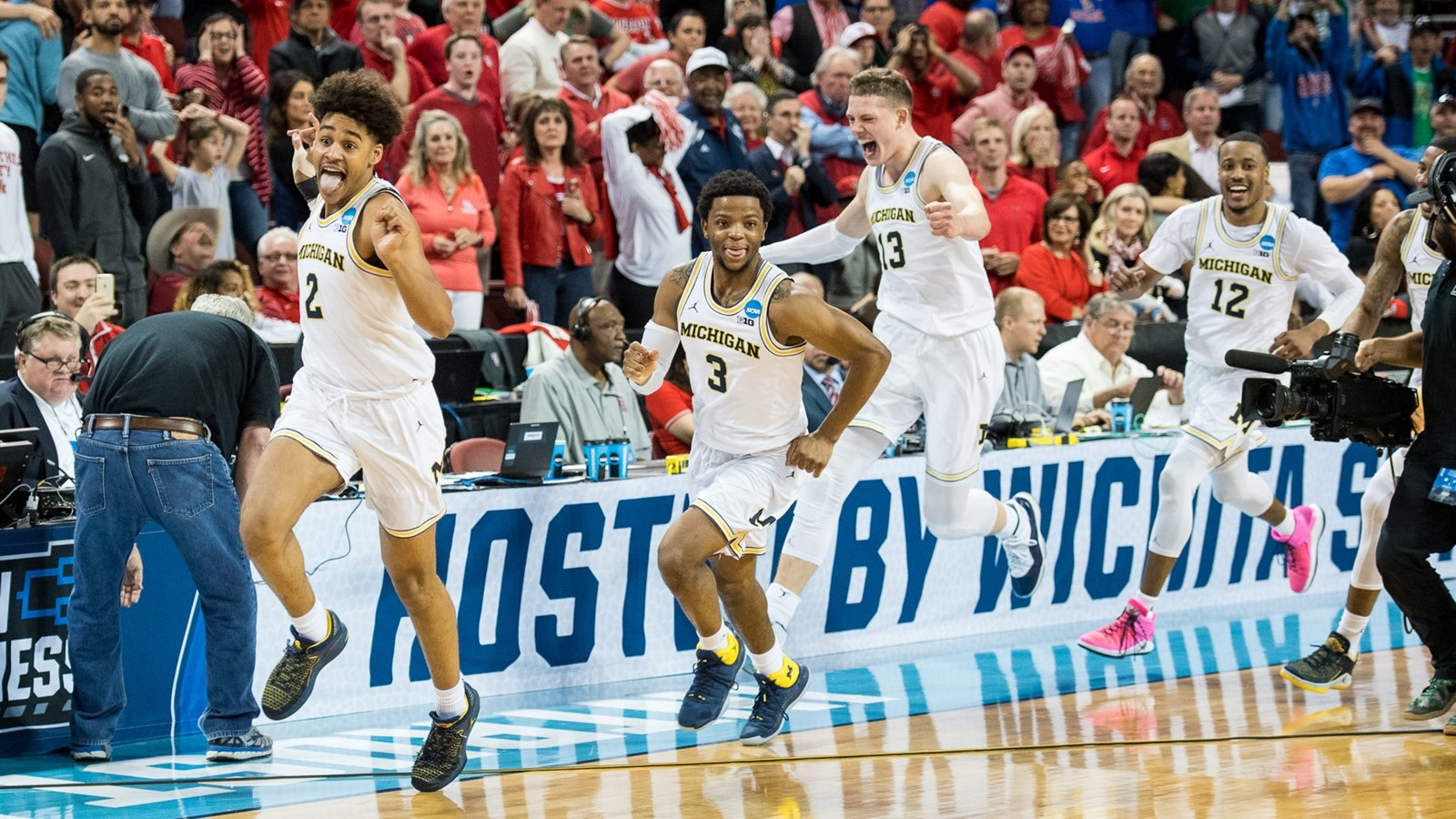 ebe64288803 Poole Party  Behind the Game-Winning Shot That Has Michigan Moving ...